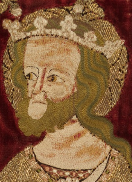 Chasuble (Opus Anglicanum Embroidery) - Man's Face Detail showing arched stitches along the brow and eyelid, a small spiral on the closer cheek, vertical stitching down the length of the nose, and curved stitches along the chin. This Chasuble is in the collection of the Met Museum at http://metmuseum.org/art/collection/search/466660