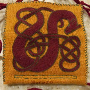 Great Wyrm Needle Book - Red Wyrm Detail, by Sidney Eileen, Stem stitch in DMC cotton floss on linen, hand stitched with linen thread.