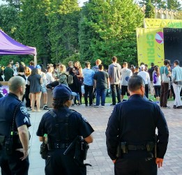 On the far right, police Deputy Chief C. Maczala of the UWPD leads his team of police officers as they keep a watchful eye over the activities of the 2015 Spring Show in Seattle, Wash., Thursday, May 14, 2015. Their main task at hand is to keep the event safe and risk free. (Photo by Sidney Sullivan)