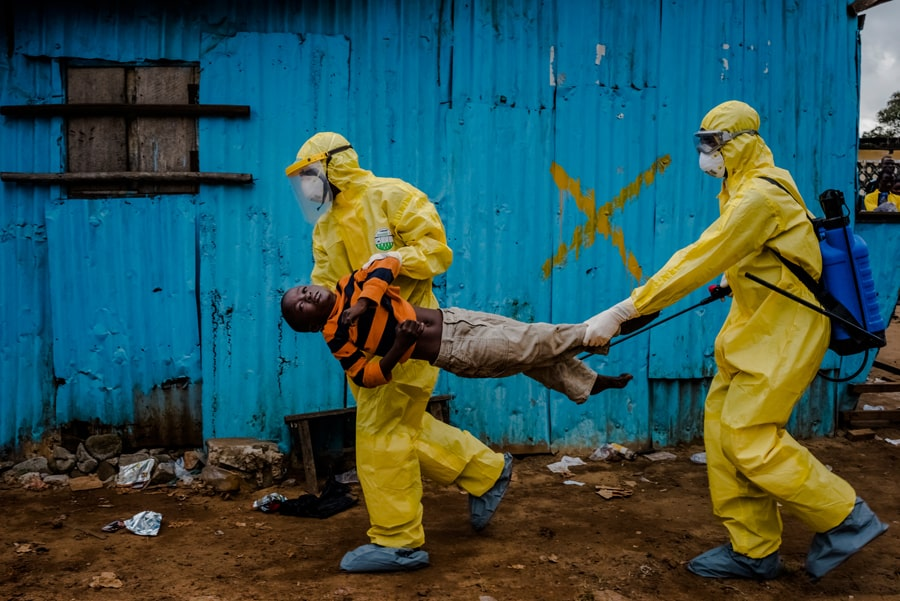 5. Sept. 5, 2014. James Dorbor, 8, suspected of being infected with Ebola, is carried by medical staff to an Ebola treatment center in Monrovia. The boy, who was brought in by his father, lay outside the center for at least six hours before being seen.