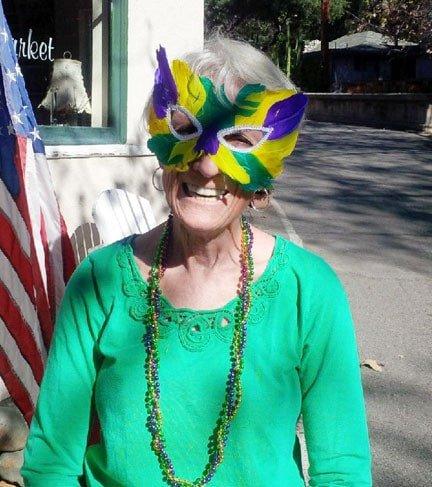 Sierra Madre Kiwanis member Joy Barry celebrated Mardi Gras at Mary's Market with friends
