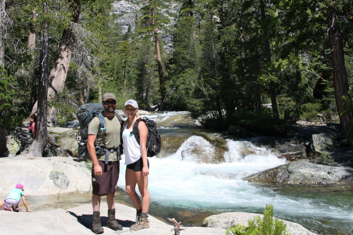 backpack couple Twin bridges into Desolation wilderness