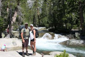 backpack couple Twin bridges into Desolation wilderness