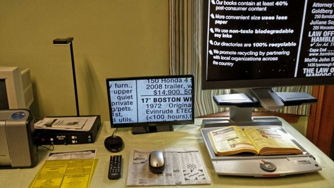 A display of reading devices for vision impaired.