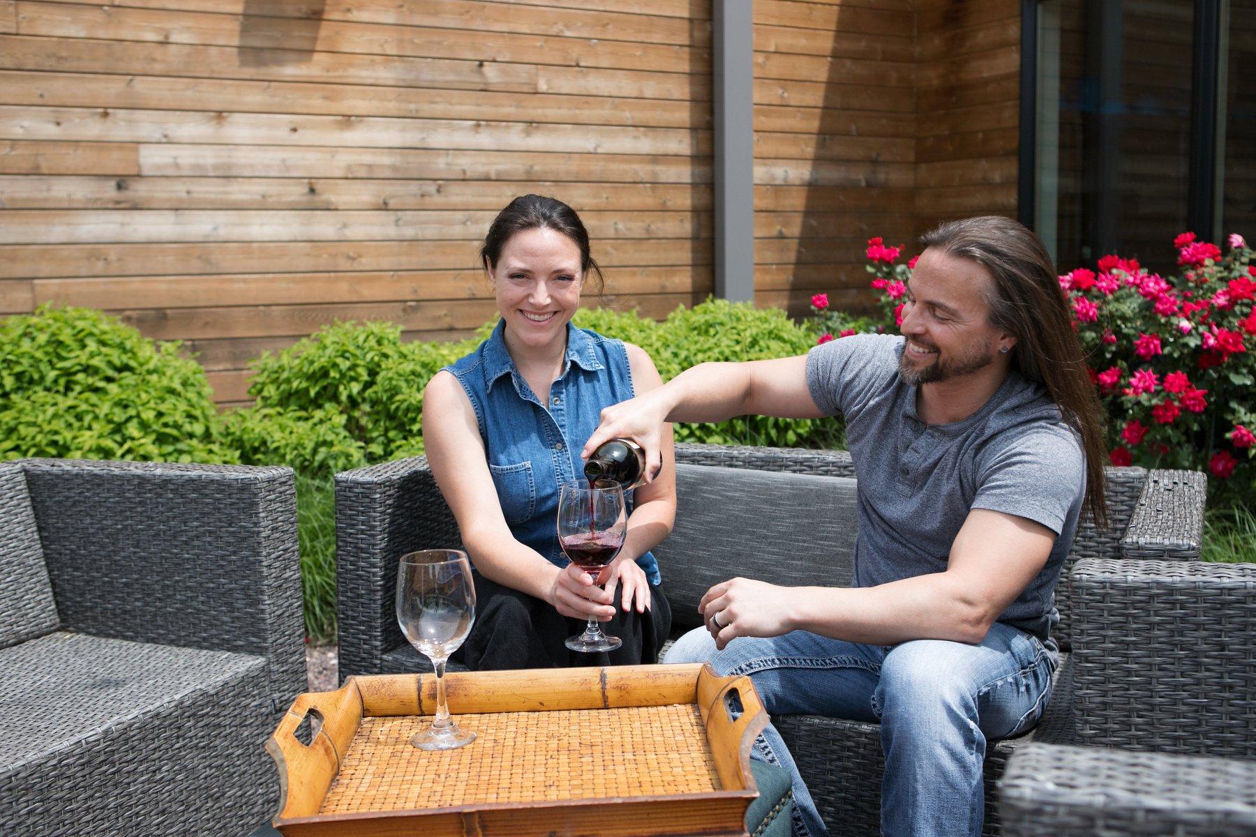acacia spa springfield missouri courtyard springtime flowers couple wine smiling