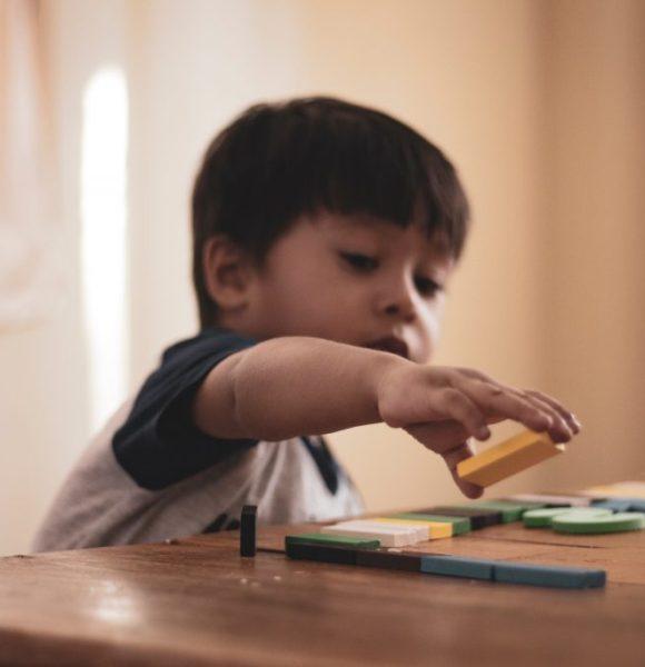 boy-holding-block-toy-1598122