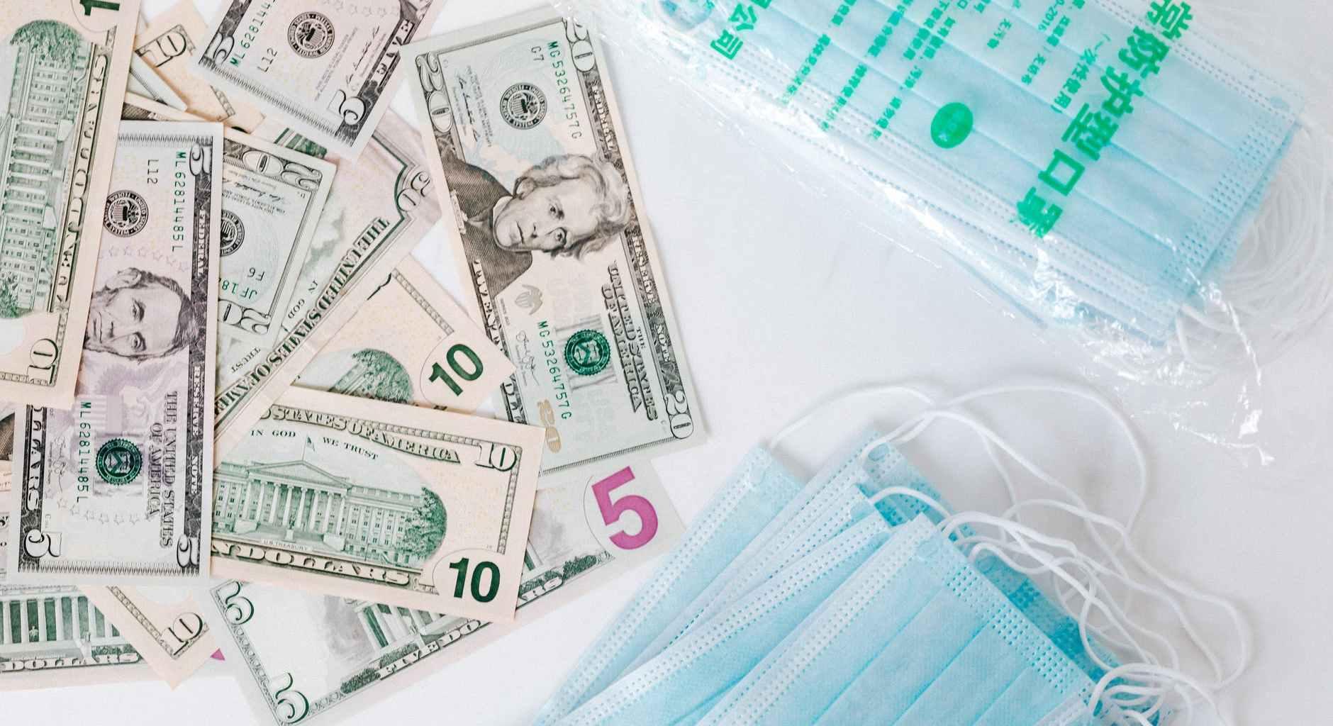 set of american cash money and medical facial masks