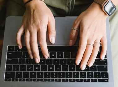 crop unrecognizable woman working on laptop