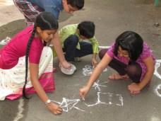 Drawing Muggulu (Rangoli)