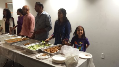 Kids helped serve food during the AID conference. Thanks, Nitya!