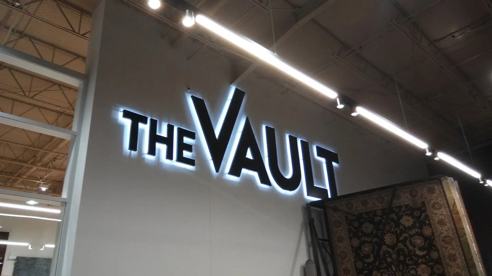home page banner - the vault sign