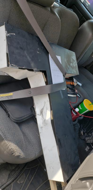 Seatbelt over the damaged letter T