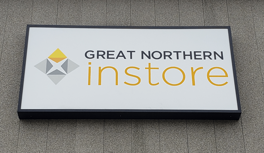 Great Northern Instore cabinet sign on exterior wall