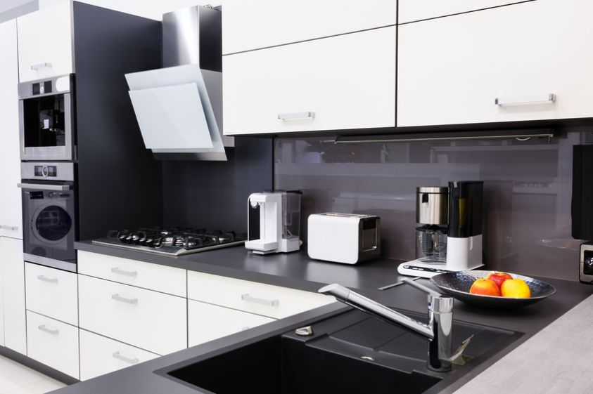 Modern luxury black and white kitchen in high tech style