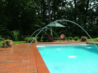 brick pool deck with arcing jets