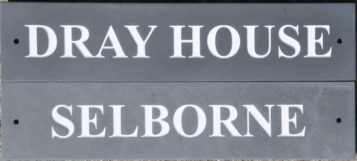 Slate house name signs with white lettering