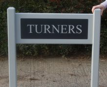 Painted wooden Entrance Sign with Corian inesert on posts