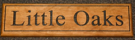 Cherry Wood House Sign - http://www.sign-maker.net/wooden/wooden-signs-cherry.htm