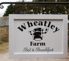 Framed painted wooden hanging sign