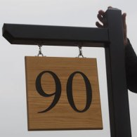 Black softwood post and arm with Oak hanging house sign