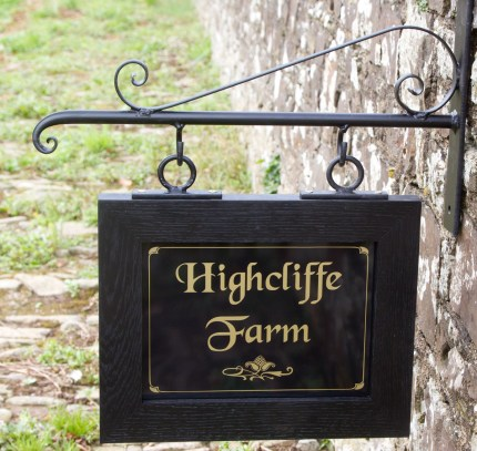 Hanging House Sign With Scroll Wrought Iron Bracket with extra scroll
