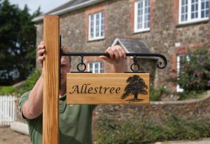 Wooden sign with Scroll Bracket and wooden post