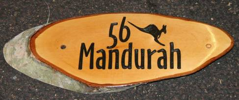 This sign was made using customer artwork http://www.sign-maker.net/wooden/rustic-wooden-house-signs.htm