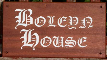 Sapele Wood House Sign. Sapele is similar to mahogany but from sustainable source. Size 455 x 250mm. Font Old English. ref - 1204.SS.046 http://www.sign-maker.net/wooden/sapele.htm