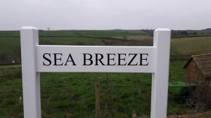Painted Wooden Sign - https://www.sign-maker.co.uk/double-sided-painted--oak-signs-23311-p.asp
