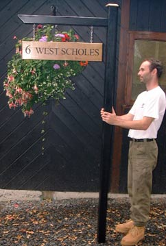 Wooden Post and arm- https://www.sign-maker.co.uk/posts-and-brackets-35-c.asp