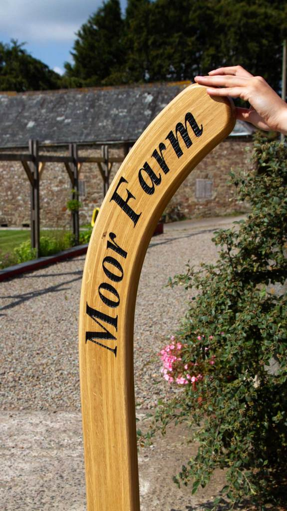 Beautiful Oak hockey stick sign designed and manufactured by The Sign Maker in North Devon