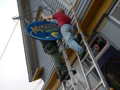Hanging the new sign.