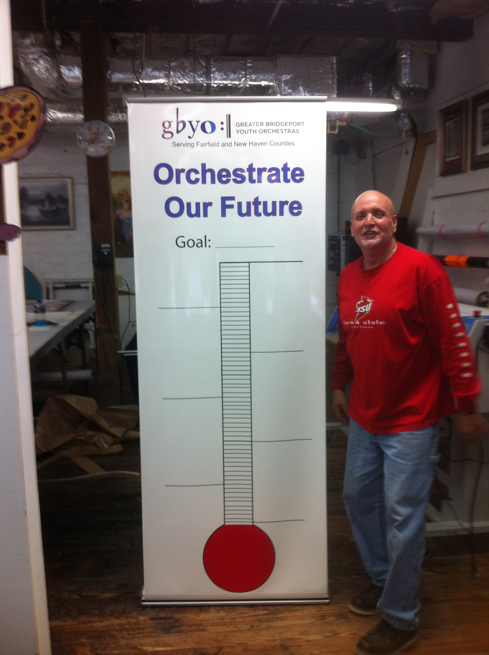 A Retractable Banner Stand Is Used As A Goal Thermometer