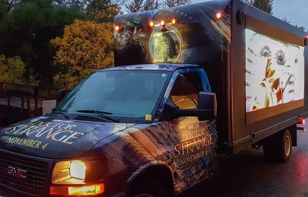 pickup van with LED screen on the side and a vinyl wrap