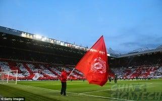 Man waving big Manchester United Flag