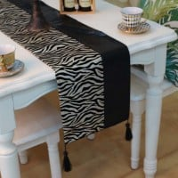table decorated with zebra design table runner