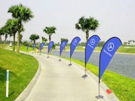 feather flags along Golf course