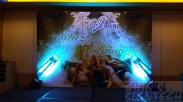 12 x 8ft event stage backdrop with champagne design when spotlights effect