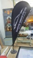 2.2m teardrop banner - Quantum Armour Pte Ltd with custom metal base