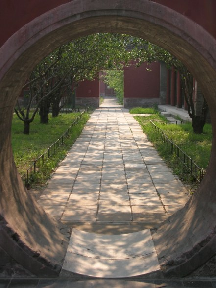 """Stepping into the gardens surrounding the Temple of Heaven, Mom filled in for our tour guide, """"So, this temple was built in the fifteenth century."""""""