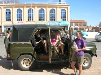"""""""The tiny five-seater, war-torn Russian jeep was already occupied by five sweaty passengers."""""""