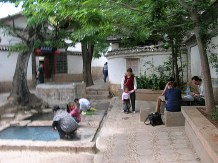 A. We found ourselves at one of many local watering holes, each consisting of a three-tiered system of square, cement pools surrounded by a small courtyard.