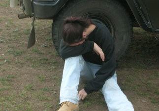 Bree was already sitting on the ground with her back against the tire of the truck. Her head hung nauseously between her legs. She groaned more than the sheep ever had.