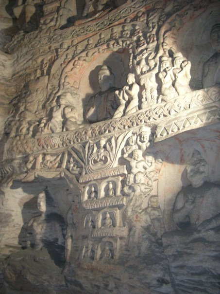The caves are man-made and there are 51,000 Buddha statues carved into the walls inside the cliffs.