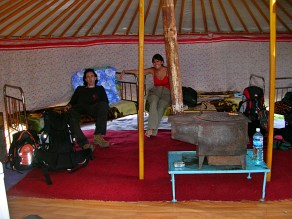 My first visit to a local Mongolian home was a bit shocking. The ger was completely open inside, consisting of just one big, round room that held a sink, a colourful dresser, four metal-framed beds lining the felt walls, and a fireplace/stove in the middle. The roof was supported by reddish-orange poles in the traditional Mongolian style.