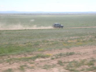 The jeep, camouflaged and worn, raced alongside us in the meadows, stirring up dust in a long trailing parachute.