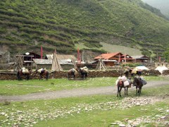 Passing by small villages on horseback.Songpan area
