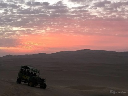 Sunset on the sand dunes in peru