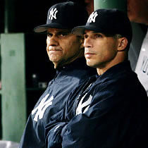 Joe Girardi (right) with his predecessor Joe Torre