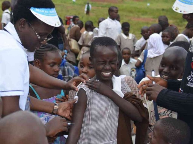 A Migori Muslim Primary school pupil grimance when Health official administering Measles Rubella vaccine. PHOTO/FILE